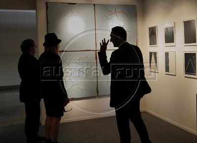 People look at a art piece by Brazilian artist Adriana Varejao on exhibit at ArtRio, International Contemporary Art Fair of Rio de Janeiro, Rio de Janeiro, Brazil, September 12, 2012. (Austral Foto/Renzo Gostoli)
