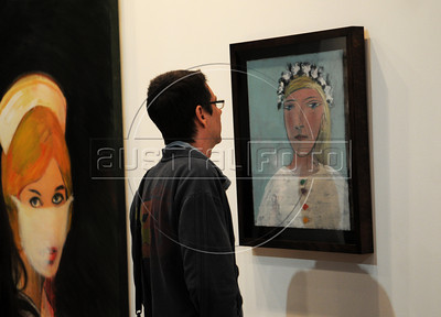 People look at a art piece by Spanish artist Pablp Picassol on exhibit in Gagossian Gallery (N.Y.) at ArtRio, International Contemporary Art Fair of Rio de Janeiro, Rio de Janeiro, Brazil, September 13, 2012. (Austral Foto/Renzo Gostoli)