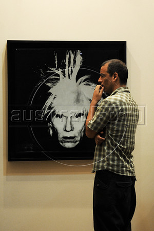 People look at art pieces by American Andy Warhol on exhibit in Gagossian Gallery (N.Y.) at ArtRio, International Contemporary Art Fair of Rio de Janeiro, Rio de Janeiro, Brazil, September 13, 2012. (Austral Foto/Renzo Gostoli)