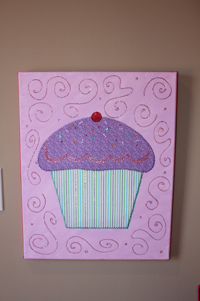 Fabric cupcake on canvas