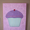 Fabric cupcake on canvas