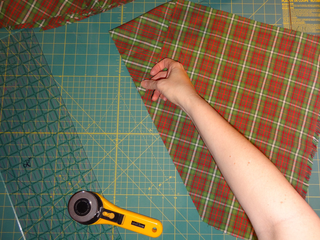 Pull the top point of the 45-degree angle down to align the cut edge.