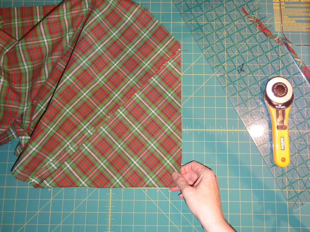 Now you can move around your cutting table or you can turn the fabric so that you can cut going the right direction.  Fabric to your left if you are right handed.  Fabric to your right if you are left handed.  Start turning the fabric 180-degrees.  It is preferable to turn the fabric.....