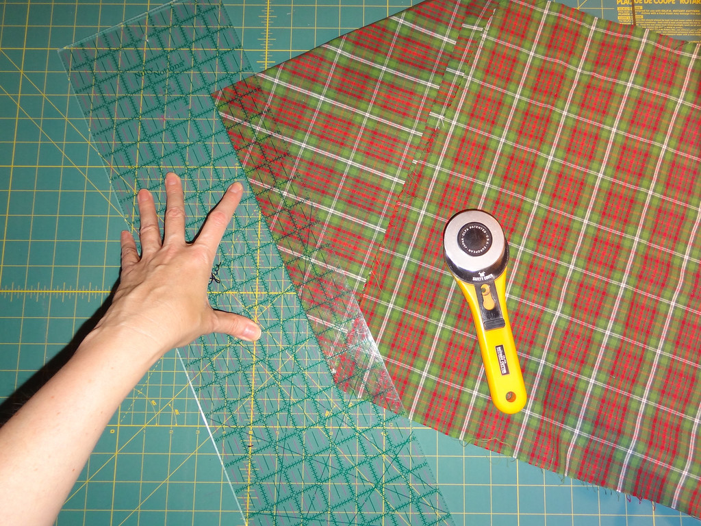 Whenever cutting strips, place four fingers on the ruler and one finger on the cutting mat to keep the ruler from twisting as you cut.