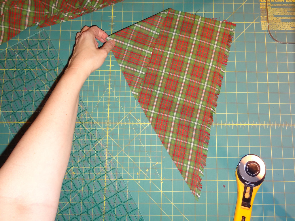 Pull the top point towards you to shorten the length of cutting.