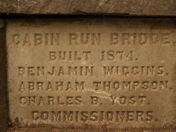 "This stone marker says ""Cabin Run Bridge"" because 2 bridges eventually crossed Cabin Run Creek. Later, this bridge was called ""Loux Bridge"", while another bridge was named ""Cabin Run."""