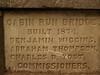 "This stone marker says ""Cabin Run Bridge"" because 2 bridges eventually crossed Cabin Run Creek. Later, this bridge was called ""Loux Bridge"", while another bridge was named ""Cabin Run."""