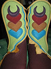 Ooooo... sometimes your body art can become your shoe art!  Here are the shields that protect this woman, transformed on to her boots.  Powerful!