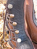 This pair is a great example of button choices and natural edge button trim in buffalo hide.  This moccasin wearer sent buttons that he had inherited from his ancestors - beautiful and heartfelt!  His boots are tobacco buffalo with deep grain, and have a chocolate buffalo natural edge button trim, with a chocolate deerskin full welt edge.