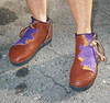 High One Button Moccasins in Tobacco Buffalo, Purple Lotus Flower Button Trim, Dusk Deerskin Natural Edge Underlay, Purple Top Welt, Copper QuickSilver Buttons, Thin Cushi, Spikeless Golf Vibram Soling.