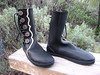 Simple can be very elegant.  This pair of black boots, with black points and curves button trim, adds a creme underlay to emphasize the design.