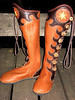 Button trim in the traditional wave pattern - going up the leg - versus down.  And going around to the inside of the leg.  A cutwork sunburst is inset at the top of the button trim.  Antler crown buttons in the medium dye finish them off.  This pair of knee high boots also has a full welt finished edge.