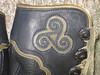 Such ancient wisdom resides in this emblem - the triskellion.  The image is cut from black deerskin, appliqued onto olive cowhide, set in black moosehide, underlay is the olive cowhide, on a black buffalo boot.