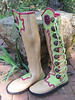 This pair of creatively wild moccasins has the 'flower' design at the bottom and the top of the lime green button trim, and the points and curves design in between.  The hot pink goat skin underlay sets off the design, as does the hot pink full welt.  The buttons are dark antler crowns.