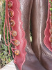 Points and curves button trim in redwood bullhide on a chocolate boot.