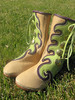 The traditional wave button trim going down the leg and crashing into Sharon's wave design at the bottom.  Lime green button trim with a purple deerskin underlay, on a sand boot, with a purple top welt, and QuickSilver buttons.<br /> I'm sorry to let you know that I can't get the lime green anymore.  Darn!  It was fun!