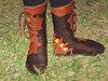 Savana's chocolate buffalo boots are trimmed in tobacco extreme flower button trim that continues around the leg.  She wanted a little splash, so the heel is made into a sunburst in gold and rust deerskin.  This pair of five button moccs are finished off with the antler sidecuts in the oval shape.  Blessings to you, Savana!