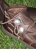 Or you can make up your own crazy button trim shape!<br /> Here the two button moccasins are shown with the silver QuickSilver buttons in two different designs.  The top welt is in chocolate deerskin.