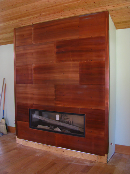 This floor to ceiling fireplace design makes the living room very artsy and welcoming. Patinad Copper. Teton Village, WY