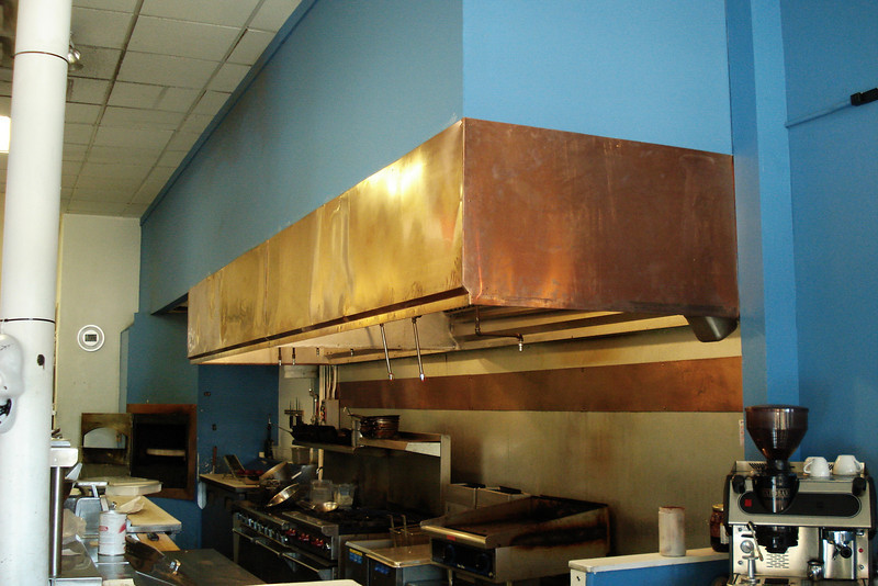 16 foot long restaurant exhaust hood. Installed and than covered with copper. With Randy William Cisneros. Taos plaza.