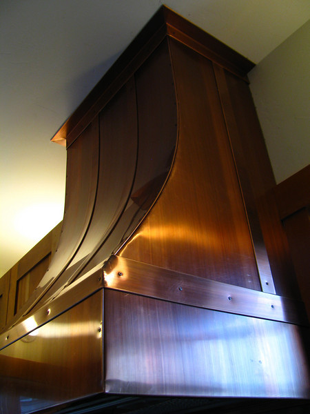KITCHEN EXHAUST HOOD. Patinad Copper. Project started from an empty wall and it became what U see. Built and installed.