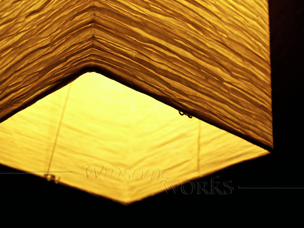 Crinkled paper lantern, from below