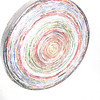 Trivet made of cut, folded strips of magazines, rolled into circle and glued.