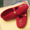 Knit, felted slippers with embroidered embellishment to match buttons.