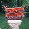 Crocheted basket using Fair Challenge fabric.