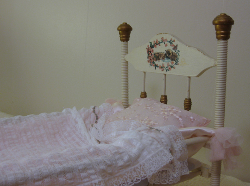 Antique cradle for sweet Stella. I added the kitten decoration and made the bedding.