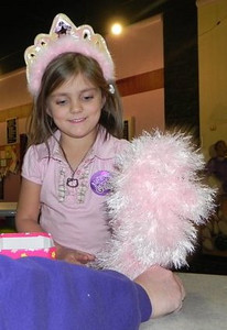 Gracie receiving her Fluffy Pink Scarf (of Doom) at her birthday party Made from Lion Brand Fun Fur in Soft Pink
