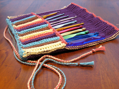 Rainbow Hook Case Made from Berroco Pure Pima in Grape Jelly, Walnut, Norse Blue, Mellow Rose, and Jojoba Pattern Rainbow Rolls by Lisa Naskrent