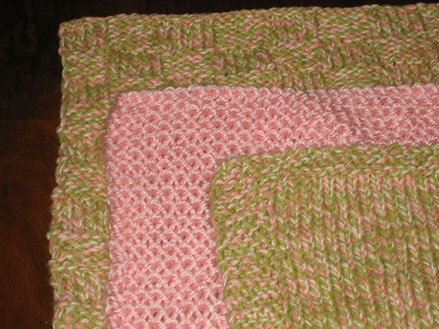 Dirty Girl Washcloths Made from Caron Simply Soft in Soft Pink and Bernat Handicrafter Cotton Twists in Ume Twist Pattern Dirty Girl Washcloths by Nancy Queen and Mary Ellen O'Connell from Chicks with Sticks Guide to Knitting