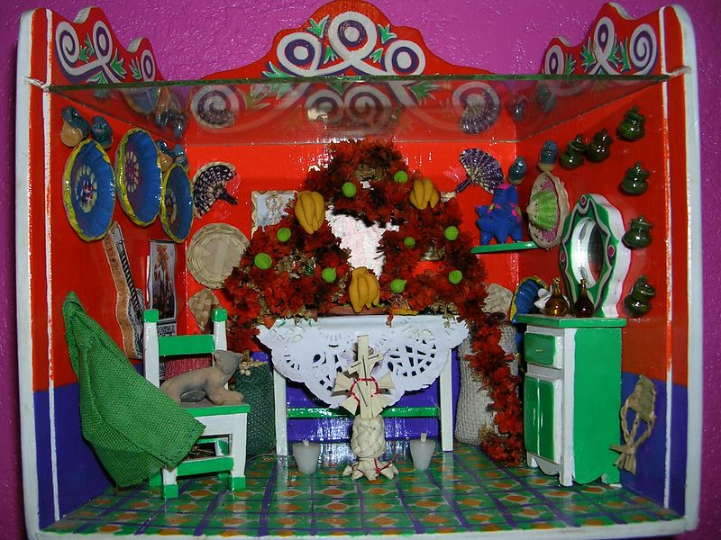 Handmade shadow box of a Day of the Dead altar made by Teresa Romero of Patzcuaro & Jose Valdez.  What cannot be seen in the photo are three religious paintings hanging on the wall behind the altar and all the food laid out on the table.