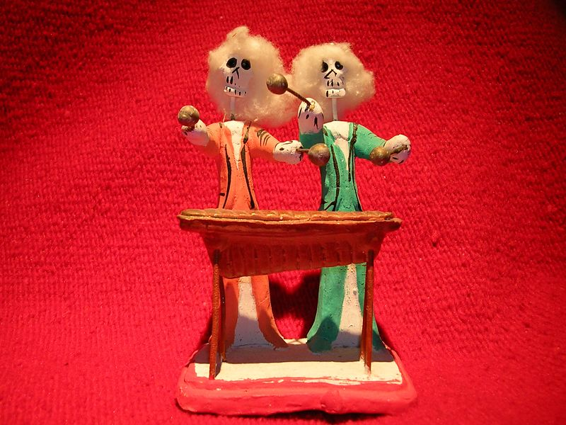 Two handmade clay figures of musicians playing a mirimba by unknown artist of Oaxaca.