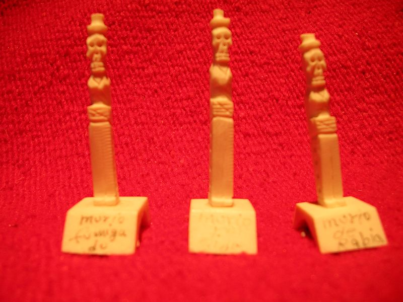 """Three tiny miniature figures carved from animal bone by Roberto Ruiz of Mexico City.  One says, """"Murio Fumigado"""" or """"died smoking.""""  Another says, """"Murio por Sida"""" or """"died of Aids.""""  And the third says, """"Murio de Rabia"""" or """"died of rabies."""" See """"Arts and Crafts of Mexico"""" by Chloe Sayer page 100 for more."""