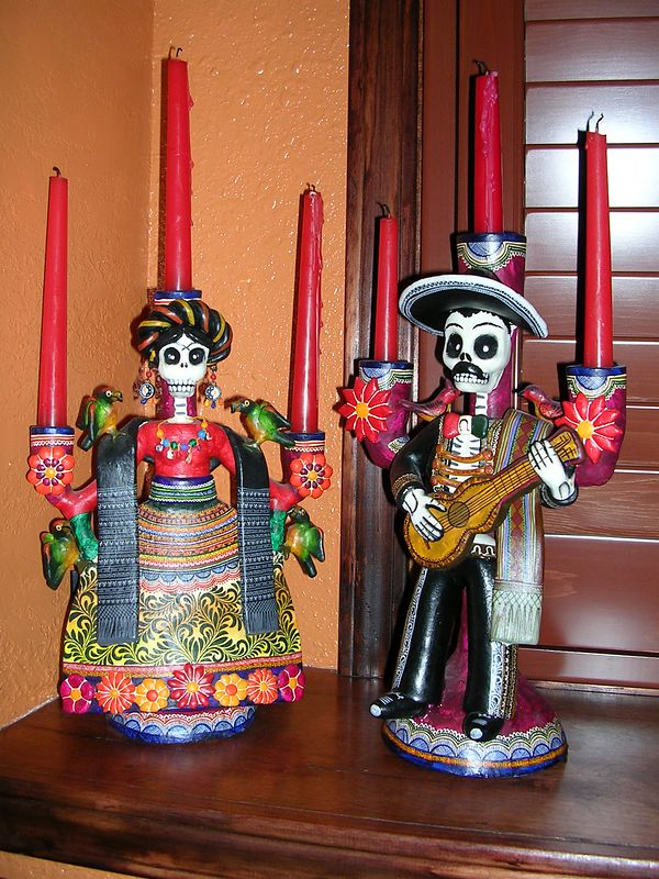 "Two handmade & handpainted clay catrinas made into candleholders by Alfonso Castillo Orta of Izucar de Matamoros, Puebla.  Purchased from the artist at his home in 2001.  Would never be used by an indigenous person in their Day of the Dead observance, but would possibly be used by urban Mexicans as part of their observance.  See ""Great Masters of Mexican Folk Art"" pages 150-153 for more information on Alfonso."