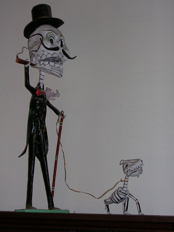 """Paper mach calavera figure with cigar, cane & dog by """"Great Master,"""" Felipe Linares of Mexico City.  For more information, see """"Great Masters of Mexican Folk Art,"""" pages 464-467."""