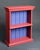 This shelf is made completely with hand tools, including all of the joinery and the molding.  The back is tongue and grooved and beaded.  It is designed to be hung from the wall with a French cleat, a very secure hanging method that is incorporated int the framework of the back.  The wood is raiata pine and finished with a water based acrylic paint.