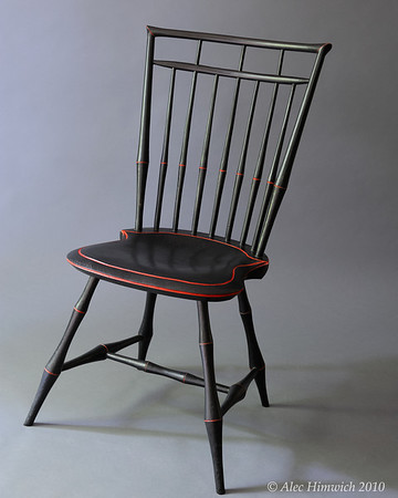 Popular during the 18th and 19th centuries, Windsor chairs have seen a resurgence in interest.  This birdcage Windsor chair shows the fascination that the West had with Oriental motifs which became common with the opening of trade with Japan and China.  <br /> <br /> The unique feature of this chair is the duckbill miters in the corners of the upper rails.  Several woods are used: pine for the seat, red oak for the spindles and double bobbin leg turnings, maple for upper and lower crest rails and side spindles.  The finish is milk paint (Lamp black and Pepper red) and tung oil.
