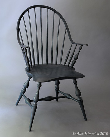 Windsor chairs were popular in the 18th and 19 centuries and are seeing a resurgence in interest.  The unique feature of this continuous arm Windsor chair is the double curve arm which constitutes the back and arms of the chair.<br /> <br /> Pine is used for the seat; red oak, for the spindles; white oak, for the continuous arm; and maple, for the arm posts and baluster leg turnings.  The finish is milk paint (Soldier Blue), and tung oil.