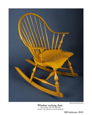 The unique feature of this continuous arm Windsor rocking chair is the double curved arm which constitutes the back and the arms of the chair and rockers.<br /> <br /> Several woods are used: pine for the seat, red oak for the spindles and rockers, white oak for the continuous arm, and maple for the arm posts and baluster leg turnings. The finish is milk paint (Mustard yellow), tung oil, and shellac.<br /> <br /> Bill Anderson is a handtool woodworking artisan specializing in American Period Furniture. Using period tools and techniques, his work focuses on traditional design and joinery. Bill teaches handtool woodworking at his shop in Chapel Hill, NC, at Roy Underhill's Woodwrights School in Pittsboro, NC, and at the John C. Campbell Folk School in Brasstown, NC.