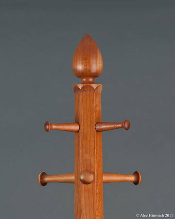 This is the top of a six foof tall cherry hat rack.