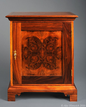 This spice chest is of a representative style of spice chests common among the Quakers of Chester County.   These chests were popular in the 18th century as a means of secure storage for valuable spices.  <br /> <br /> The primary wood is black walnut. The drawer fronts are 4 way bookmatched quilted claro walnut.  The door front is bookmatched walnut burl.  The secondary wood is poplar.<br /> <br /> Joinery is both through and half blind dovetails. The metal fittings are a mortied keyed lock and brass drawer pulls.