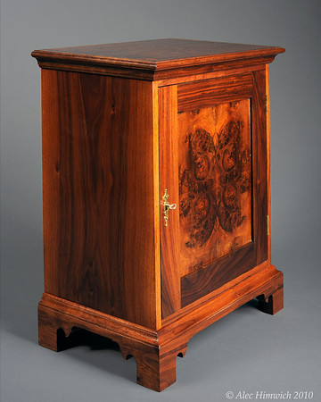 This spice chest is of a representative style of spice chests common among the Quakers of Chester County.   These chests were popular in the 18th century as a means of secure storage for valuable spices.  <br /> <br /> The primary wood is black walnut. The drawer fronts are 4 way bookmatched quilted claro walnut.  The door front is bookmatched walnut burl.  The secondary wood is poplar.<br /> <br /> Joinery is both through and half blind dovetails. The metal fittings are a mortise keyed lock and brass drawer pulls.