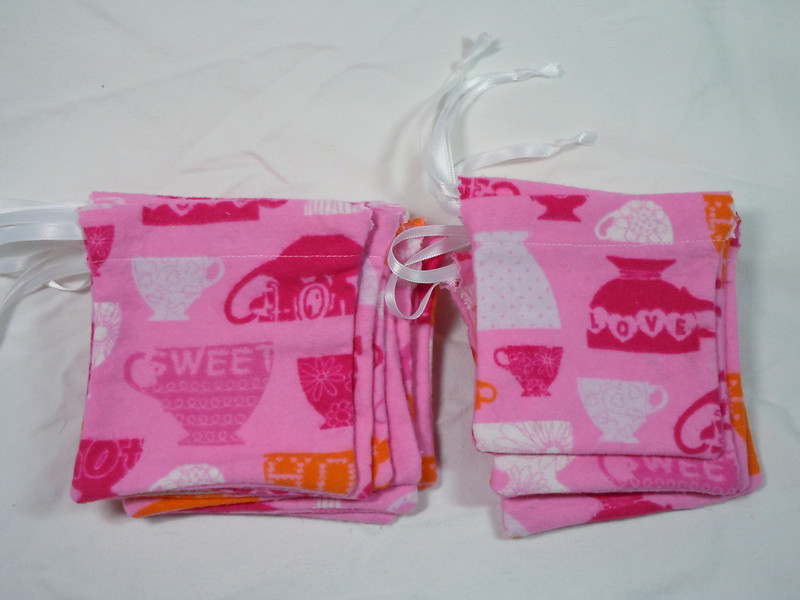 "A set of 12 Tea cup cozy flannel gift bags.  Great for showers or birthdays.  Fill with your favorite teas!<br /> 4""x4"".  One set available (I do have more of this fabric to make more of this sized favor bag), $5"