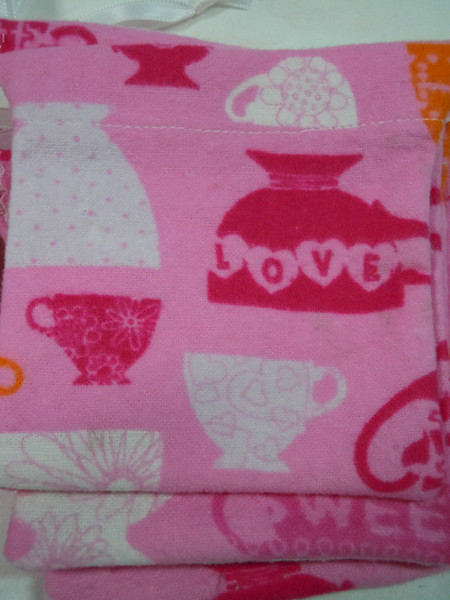 """Close up of the material<br /> A set of 12 Tea cup cozy flannel gift bags.  Great for showers or birthdays.  Fill with your favorite teas!<br /> 4""""x4"""".  One set available (I do have more of this fabric to make more of this sized favor bag), $5"""