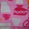 "Close up of the material<br /> A set of 12 Tea cup cozy flannel gift bags.  Great for showers or birthdays.  Fill with your favorite teas!<br /> 4""x4"".  One set available (I do have more of this fabric to make more of this sized favor bag), $5"
