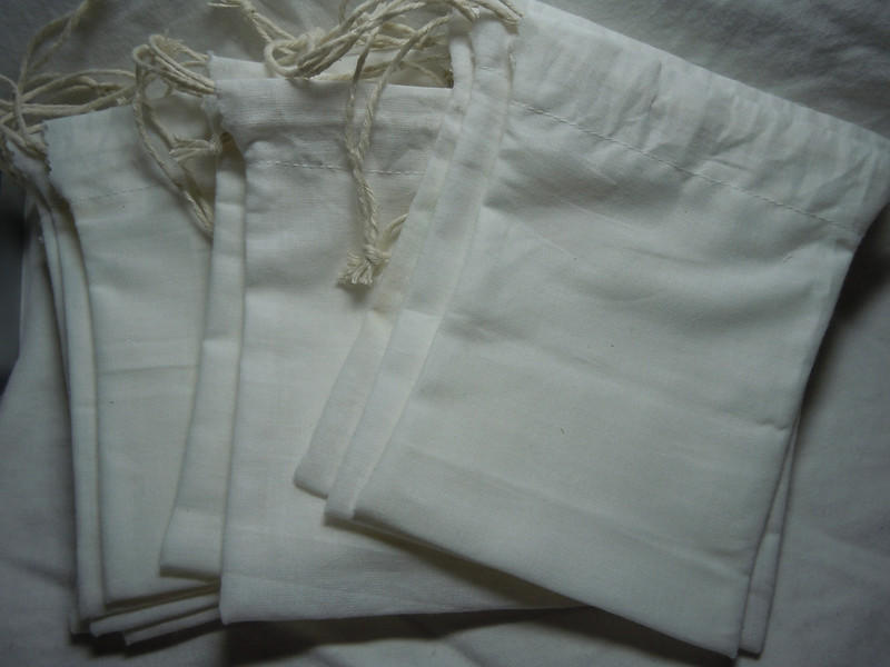 "Handmade Muslin drawstring Favor Bags with double twine string closure<br /> <br /> 4"" x 5"" of Sew Essentials Bleached White Muslin made of 100% Cotton.<br /> <br /> 12 bags can be found in this set. $5 for this set.<br /> <br /> **Please note that these are handmade so not all bags will be identical. Sizing and minor imperfections vary slightly bag to bag.**"