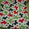 Close up of one bag<br /> Noel Collection Fabric: Christmas Scotties<br /> Item #11039666<br /> Made of 100% Cotton<br /> <br /> A set of 12 mini drawstring bags with double satin ribbon string closure. Great for christmas or holiday gifts, wedding, shower, or holiday party favors. $3<br /> <br /> **Please note that these are handmade so not all bags will be identical. Sizing and minor imperfections vary slightly bag to bag.**